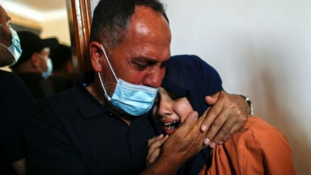 A Palestinian and his family weep for the dead in Gaza