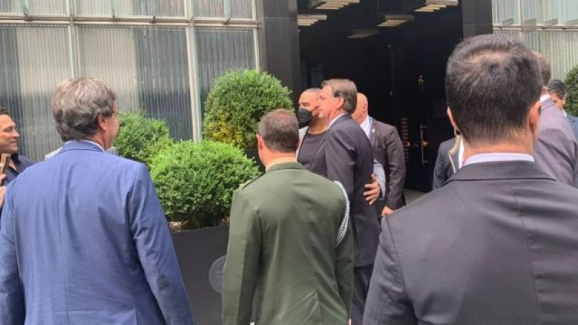 Supporters take photo with Jair Bolsonaro during Brazilian president's visit to the United States