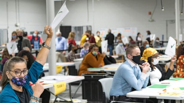 Gwinnett County election officials recount the votes on November 13, 2020, USA