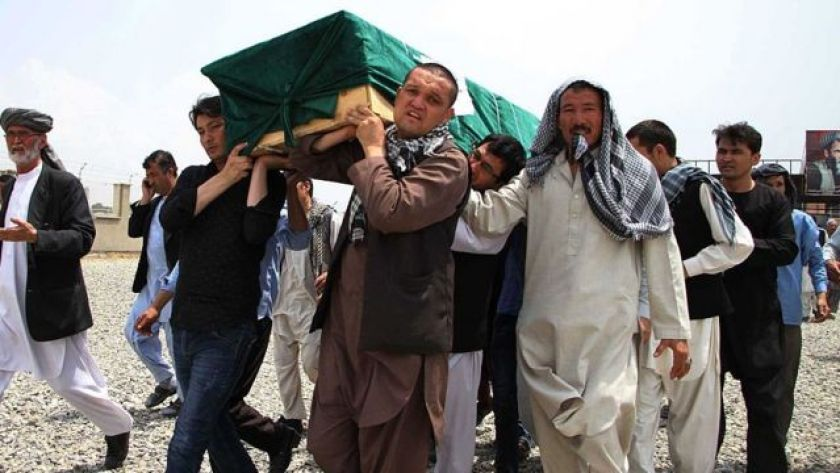 Afghans carry a victim's coffin during a funeral in Kabul, Afghanistan, on July 24, 2016, after an attack claimed by the Islamic State