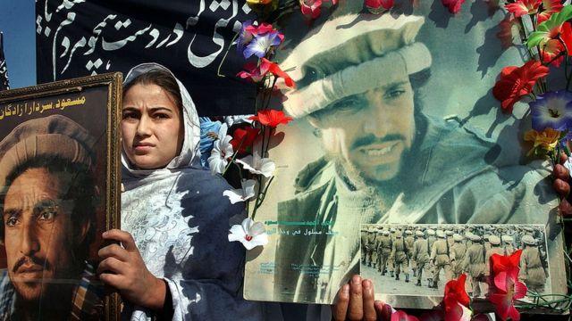 Woman with image of Ahmad Shah Massoud