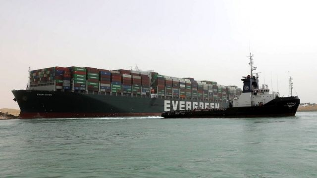 A locomotive tries to tow the tanker Evergreen off the Suez Canal on March 25th