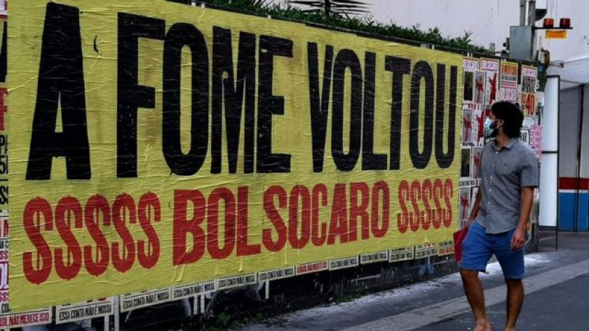 'Hunger is back,' says a protest poster on Avenida Paulista, in São Paulo