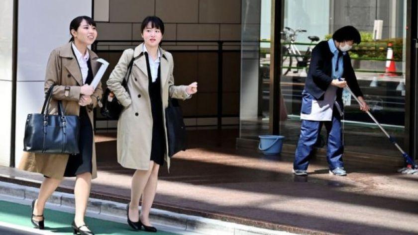 two women walk in tokyo