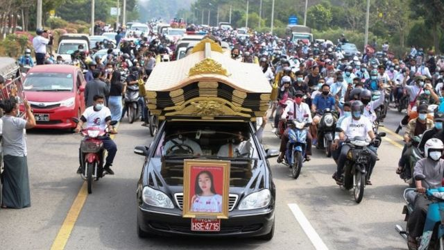 A hearse carries the body of the slain Myanmar protester Mya Thwe Thwe Khaing