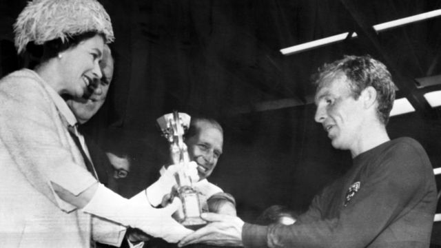 The Queen presents Bobby Moore with the Jules Rimet Trophy for winning the 1966 World Cup