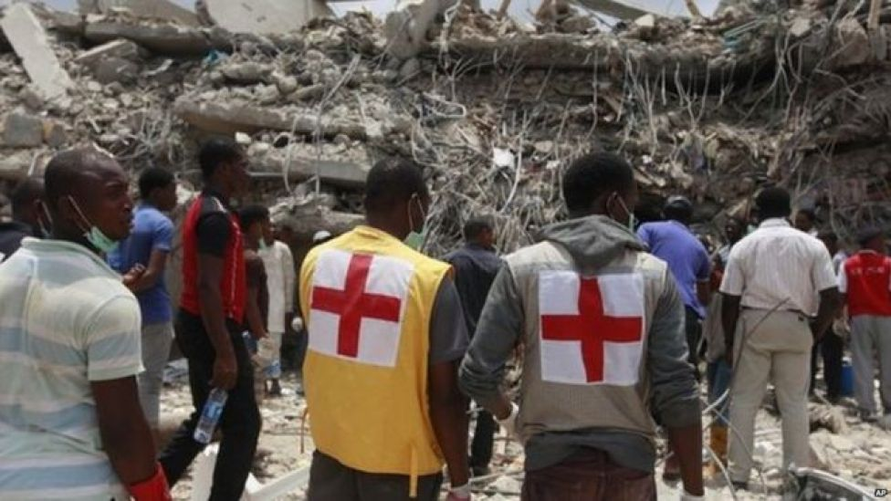 Rescue workers search for survivors in the rubble of a collapsed building belonging to the Synagogue Church of All Nations in Lagos on Saturday, 13 September.