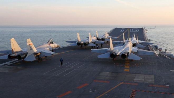Chinese J-15 fighter jets on the deck of the Liaoning aircraft carrier during military drills in the Bohai Sea, off China's northeast coast in December