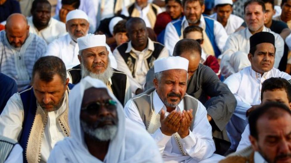 ibyan Muslims perform the Eid Al-Adha morning prayer at the Martyrs Square of the capital Tripoli on August 11, 2019. -