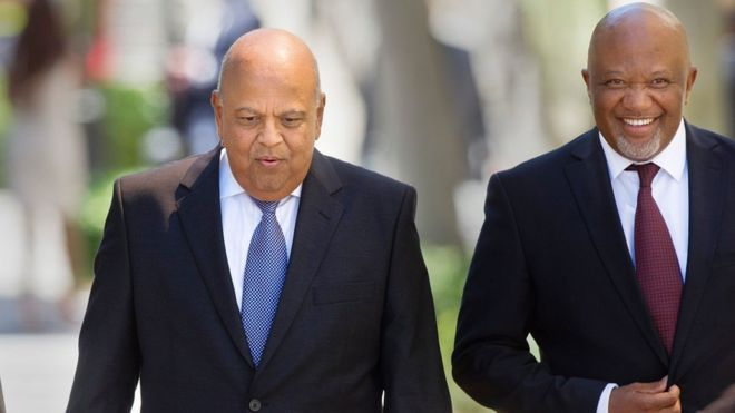 "South Africa""s Minister of Finance Pravin Gordhan (L) and Deputy Finance Minister Mcebisi Jonas (R)"