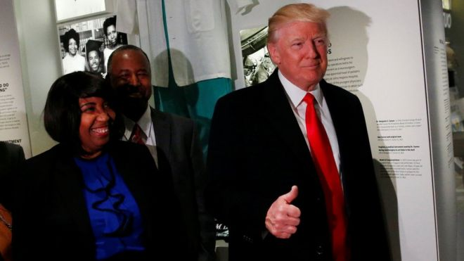 US President Donald Trump (R) gives the thumb-up while visiting the National Museum of African American History and Culture in Washington