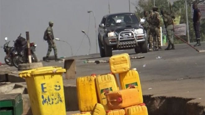 A still image from video of soldiers who have taken control of Bouake standing at a checkpoint in Bouake, Ivory Coast January 6, 2017