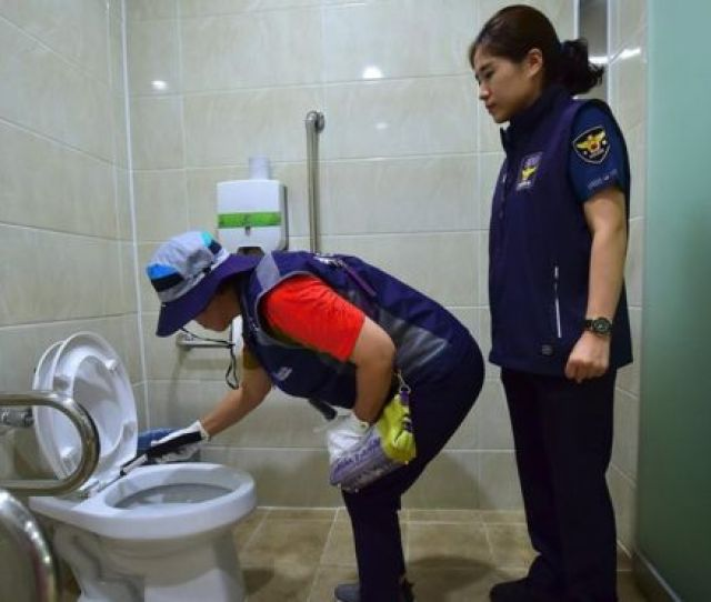 A Member Of Seouls Hidden Camera Hunting Squad And A Police Women Inspect A