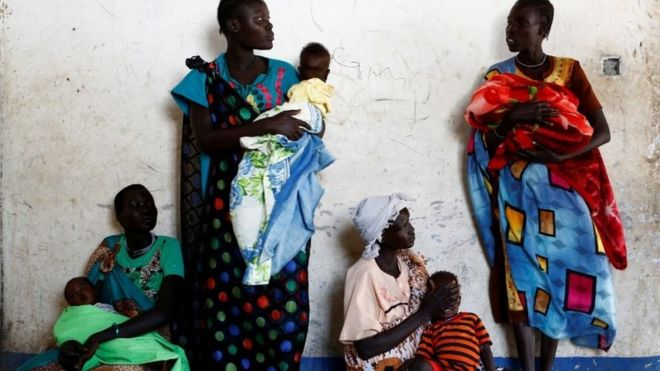 Women hold their babies as they wait for a medical check-up at a Unicef-supported mobile health clinic in Nimini village, Unity State, South Sudan