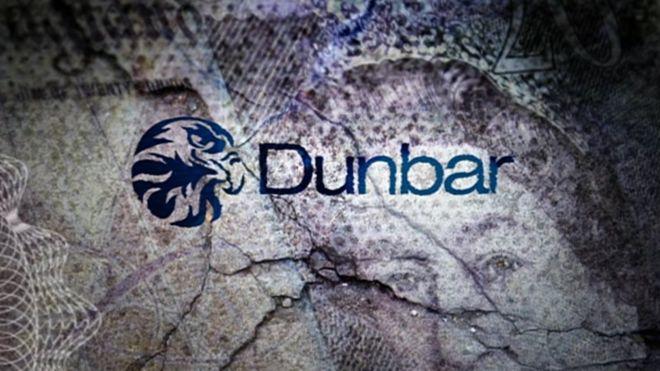 Dunbar bank logo on background of bank notes