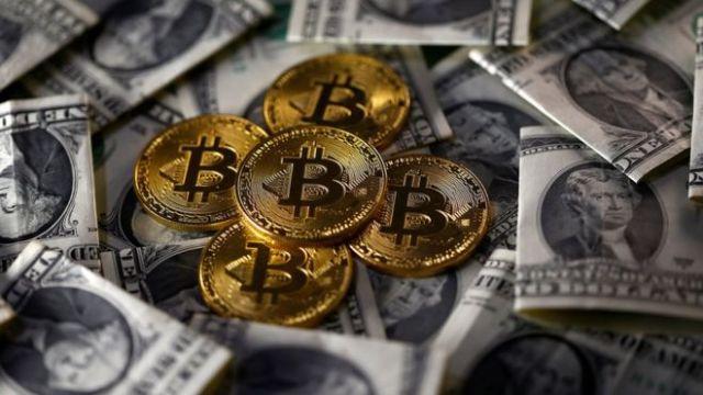 Bitcoins and dollar notes