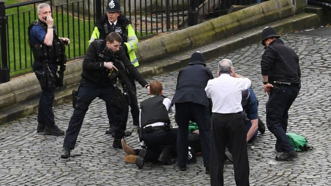 Police hold a gun to a man on the ground