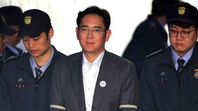 Lee Jae-Yong escorted by prison guards in April