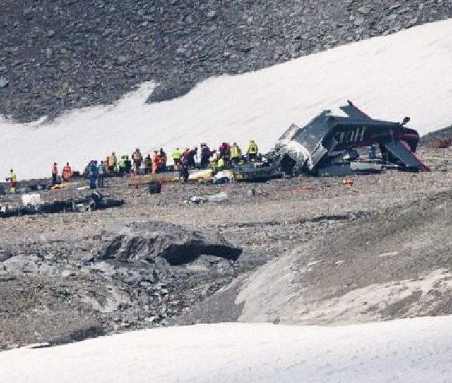 Accident Investigators And Rescue Personnel Work At The Wreckage Of A Junkers Ju52 Aircraft In Flims
