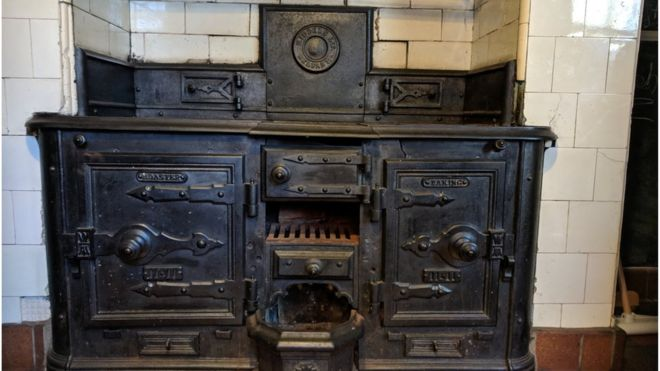 cast iron kitchen stove blue green glass tile backsplash how an old ended up as museum exhibit bbc news