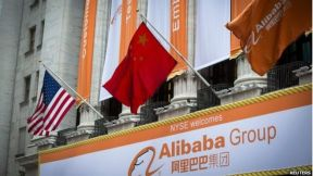 US, Chinese and Alibaba flags outside NYSE