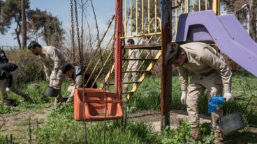 Explosives being cleared from a former playground in East Mosul