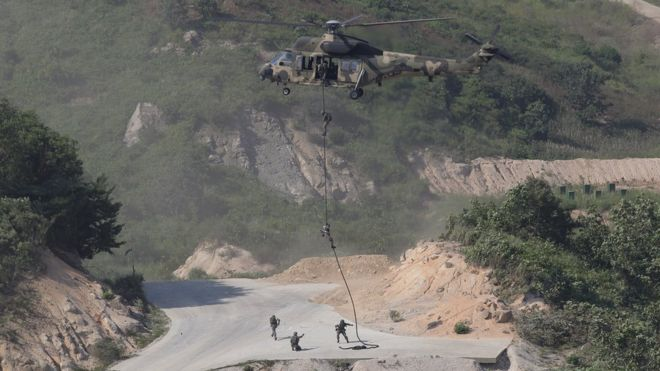- AUGUST 28: An KUH-1 Surion helicopter hovers during the South Korea and U.S. joint military exercise at the Seungjin firing drill ground on August 28, 2015 in Pocheon, South Korea