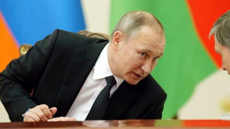 Russia's President Vladimir Putin (L) and his aide Yuri Ushakov in St Petersburg, Russia, on 26 December