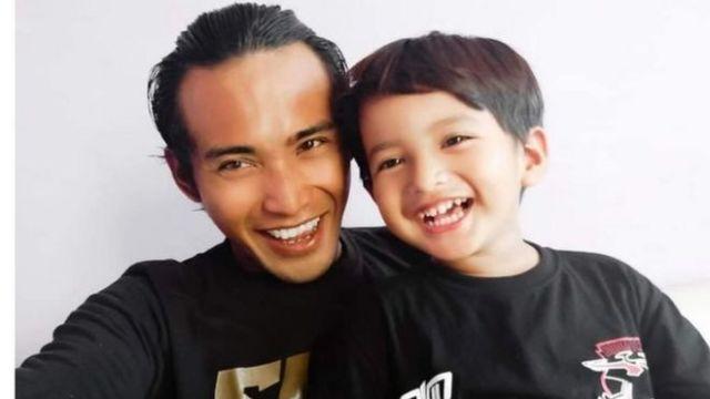 Zulia Mahendra with his son.