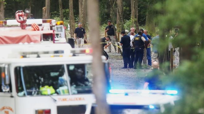 Authorities work the scene of a plane crash at a park along Robert Cardinal Airport Road across from the Tuscaloosa Regional Airport in Northport, Ala., Sunday, Aug. 14, 2016