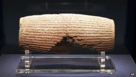 In this image provided by The Smithsonian Institution, the Cyrus Cylinder is seen on display at the Smithsonian's Freer Sackler Gallery in Washington