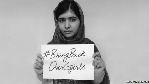 Malala Yousafzai supporting a social media campaign over the abduction of 276 schoolgirls in Nigeria