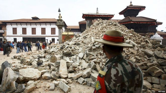A Nepalese army personnel stands in front of a collapsed temple a day after an earthquake in Bhaktapur, Nepal (April 26, 2015)