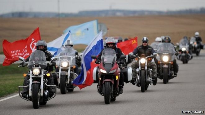 Members of the Russian Night Wolves Motorcycle Club ride to the Mount of Glory memorial complex in the village of Sloboda, some 25 kilometres east of Minsk, to honour Soviet soldiers of WWII, on 26 April 2015.