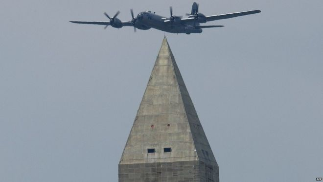 A Boeing B-29 Superfortress flies over the Washington Monument