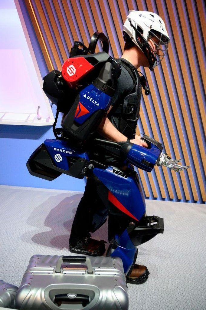 A man trying out Sarcos Robotics' exoskeleton