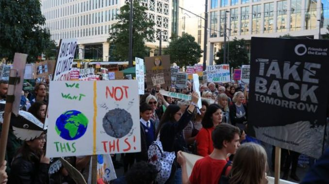 """Protesters at the UK Student Climate Network""""s Global Climate Strike in Manchester."""