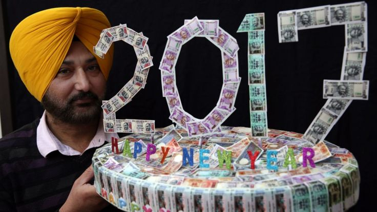 Indian artist Harwinder Singh Gill displays his new artwork made with pictures of Indian currency notes on New Years eve in Amritsar, India, 31 December 2016.