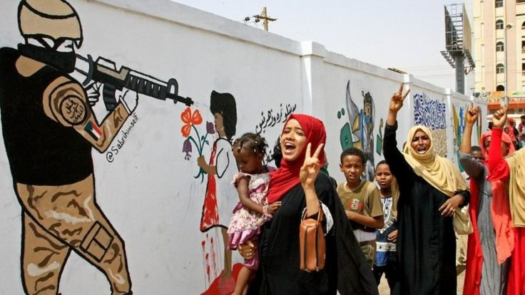 Demonstrators celebrate in Khartoum after a military rulers and protest leaders signed a constitutional declaration paving the way for a transition deal, 4 August