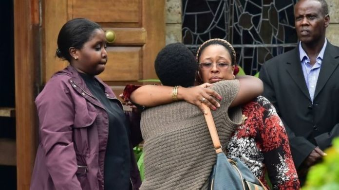 "Relatives and friends consoles a family member outside the Lee Funeral Home, following the death of former Kenya""s president Daniel Arap Moi, in Nairobi on February 4, 2020."