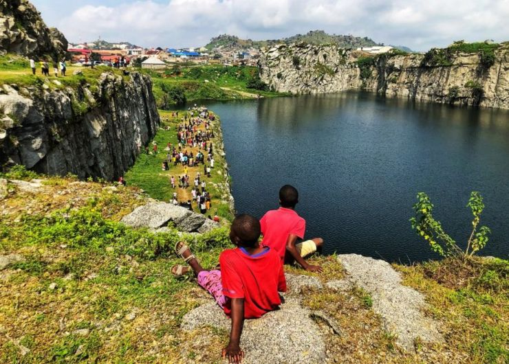 Two children look over Mpape Crushed Rock near Abuja, Nigeria