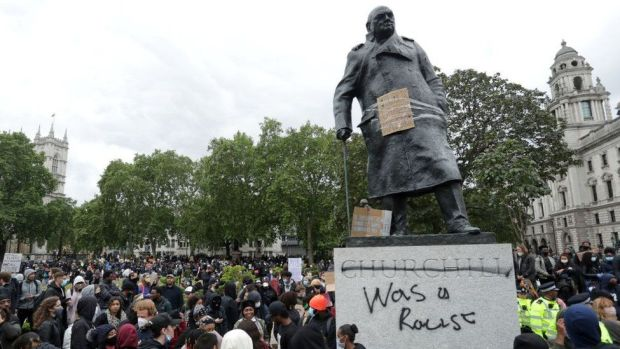 Statue of Churchill with graffiti calling him a racist