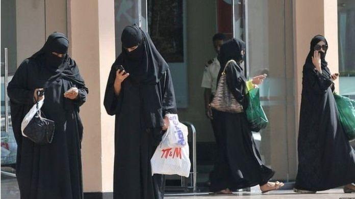 Women wear the abaya on street in Saudi Arabia