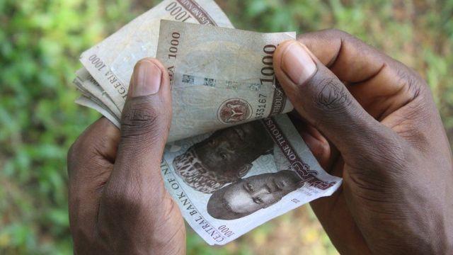 Holding naira notes