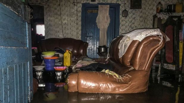 A leather sofa in a flooded living room