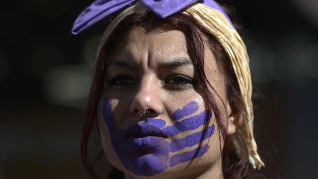 A woman takes part in a protest on the International Day for the Elimination of Violence against Women in Buenos Aires on 25 November, 2019.