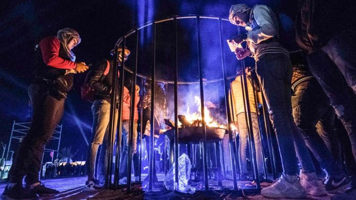 People around a fire at the Dunes Electronique music festival in Ong Jmal, Tunisia - Saturday 16 November 2019