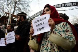 Kashmiri journalists hold placards during a protest against the high handedness of Indian forces in Srinagar, Indian Administered Kashmir on 18 December 2019.