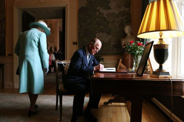 Signing the visitors book at Hillsborough Castle, Belfast