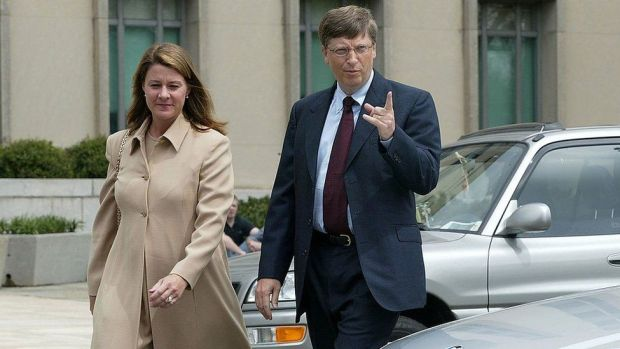 Bill Gates arrives at U.S. District Court with his wife Melinda April 22, 2002 in Washington, DC. Gates is taking the witness stand to give his first live testimony since the antitrust case was filed against the software giant in 1998.